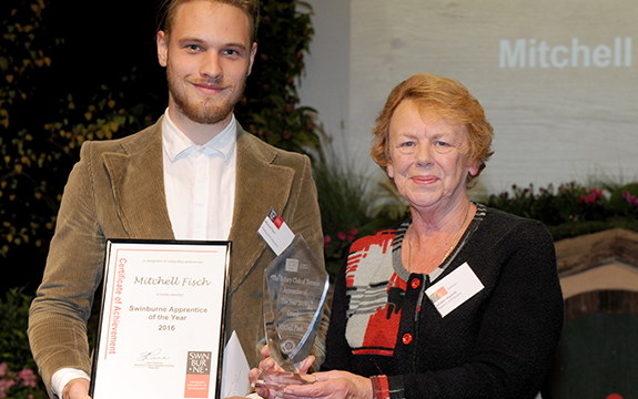 Annette Haworth of the Rotary Club of Boronia (right) presenting Mitchell Fisch with the Swinburne Apprentice of the Year award.