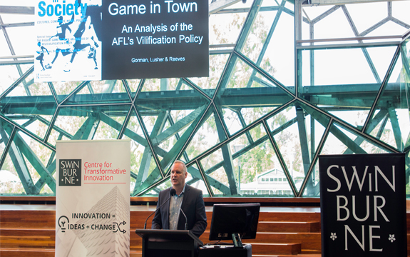 Dean Lusher presents at the AFL book launch at federation square