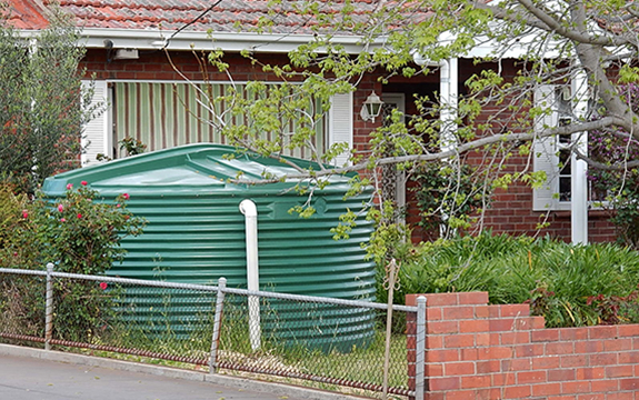 rainwater tank in front of house