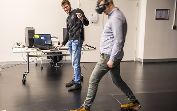 Two people using a VR headset and program.