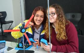 Two secondary students playing with equipment in Wantirna's KIOSK