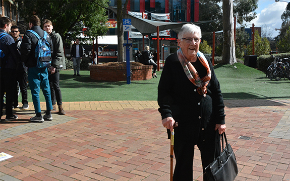 85 year old Anne Scott is standing out in the sunshine at the Swinburne campus.