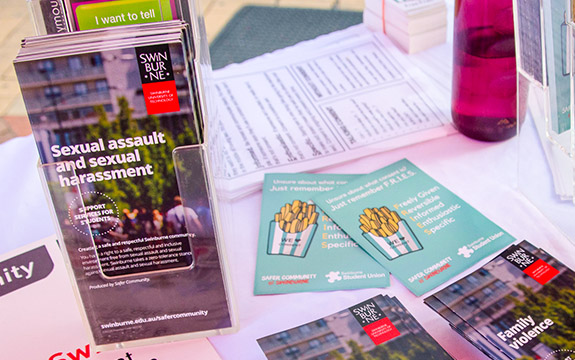 Support brochures on a table.