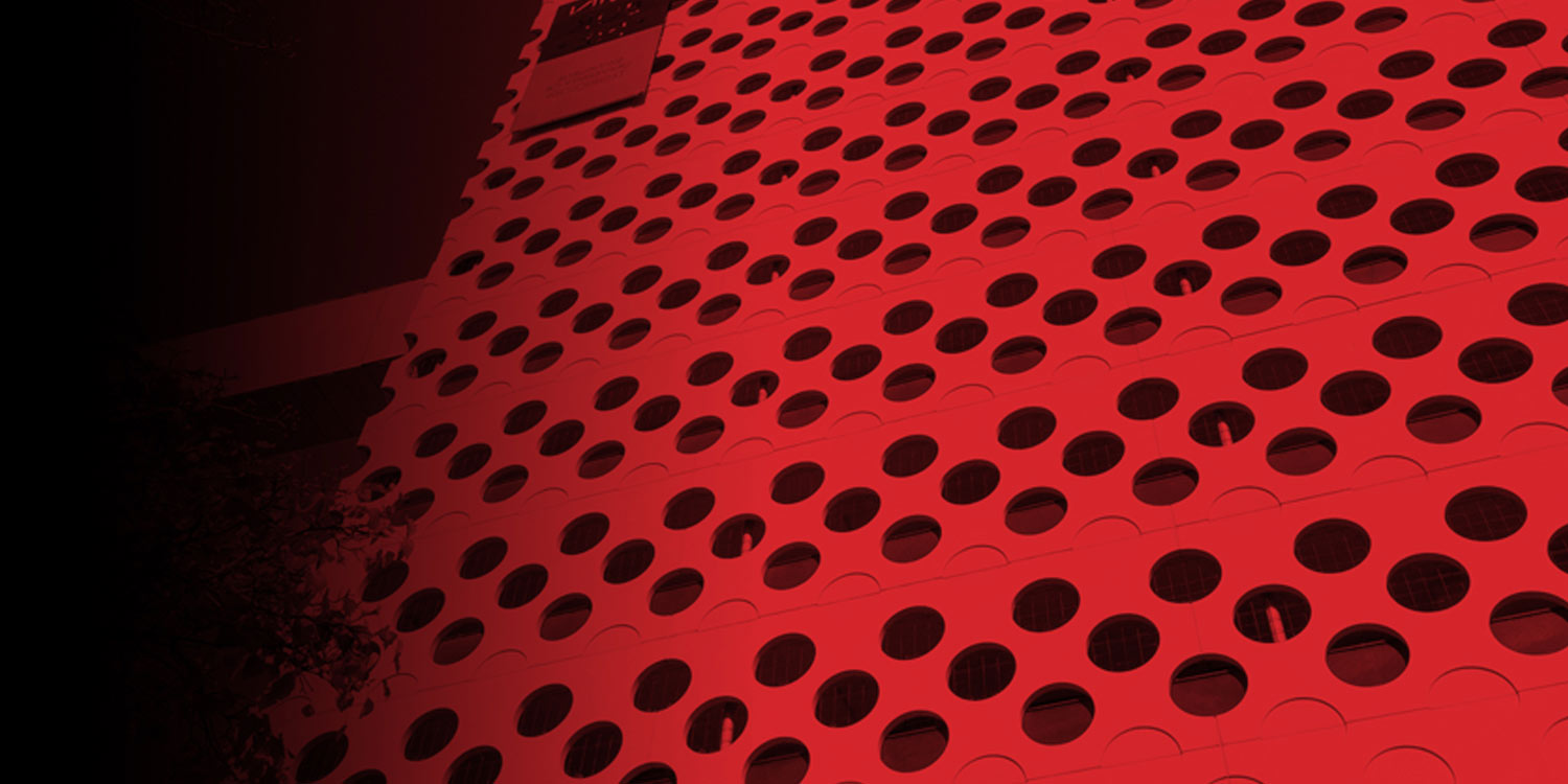 Abstract view of a Swinburne University building depicting a circular hole textile surface.