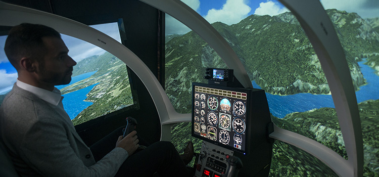 A researcher in Swinburne's helicopter simulator.