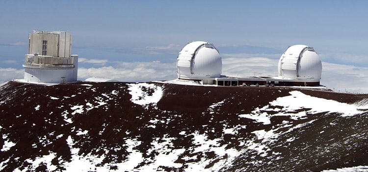 The twin Keck telescopes in Hawaii. Photo by Karl Glazebrook.