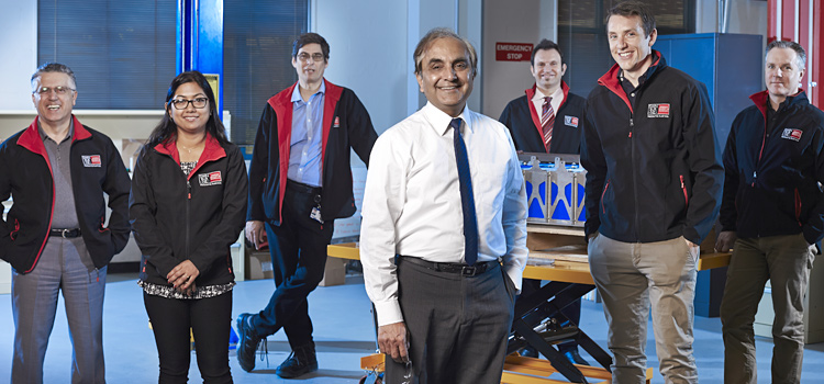 Professor Ajay Kapoor with members of the Electric Vehicle Lab research group