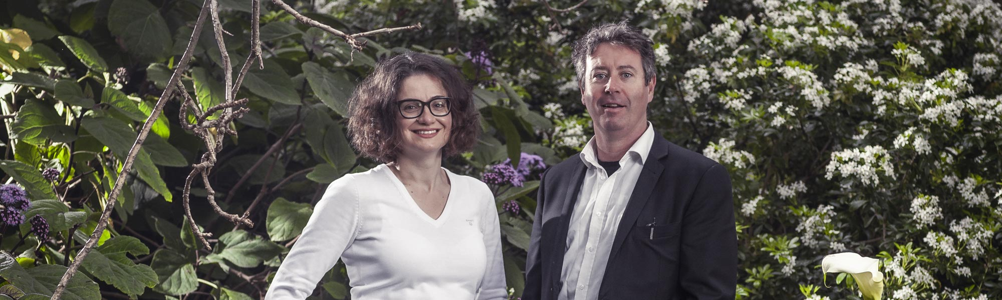 Professor Niki Frantzeskaki, Director of Swinburne's Centre for Urban Transitions, and Dr Stephen Glackin, a Senior Research Fellow at the centre, stand infront of a garden.
