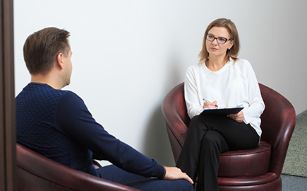 A female therapist talking to a male client