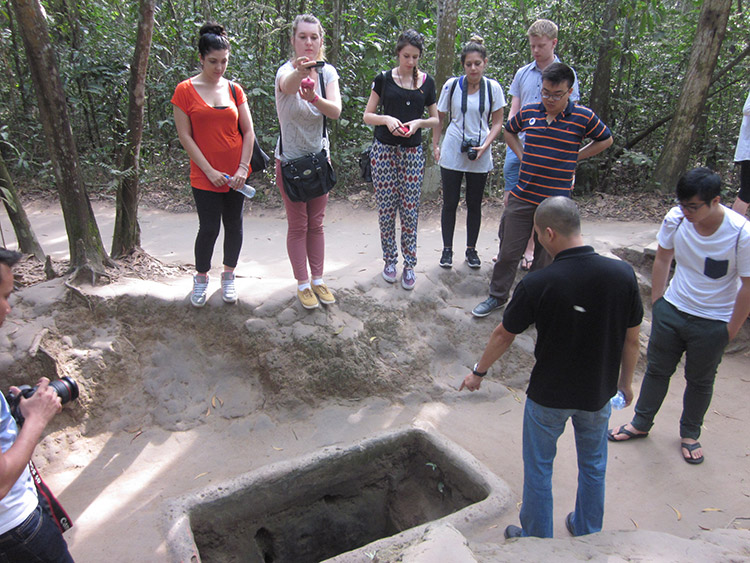 Students from 2015 Design-centred Vietnam study tour explore the Cu Chi tunnels in Ho Chi Minh City, Vietnam.