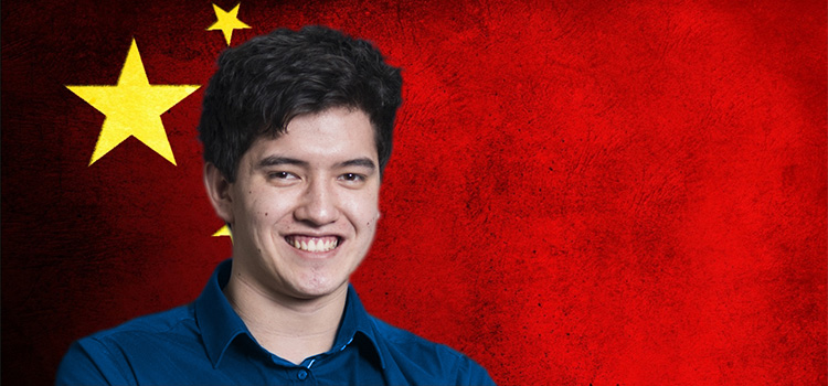 Albert, who took the Future Leaders Study Tour to China, pictured in front of the Chinese flag.
