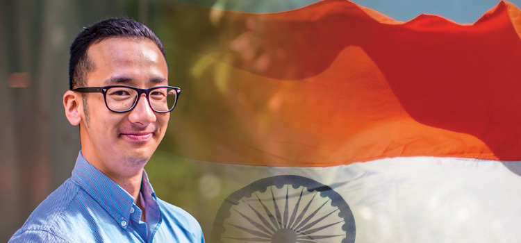 Liem, who took the IT for Social Impact Study Tour to India, against a backdrop of the Indian flag.