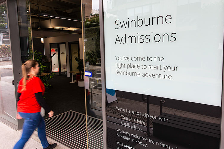 A girl walking into the Swinburne Admissions Office.