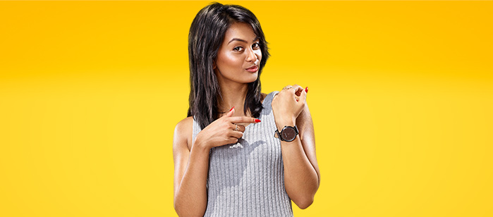 699x308 _ Sophia pointing at watch _ JIE campaign image