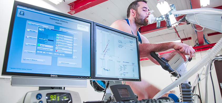 Biological data is displayed on a monitor during a health and wellness test being conducted in an exercise science environment.