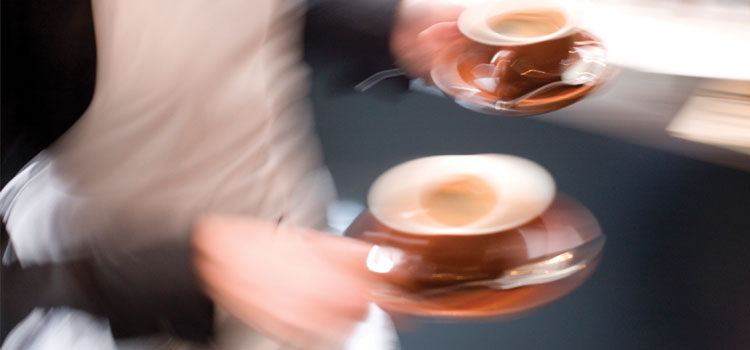 Blurry photograph of two coffee cups