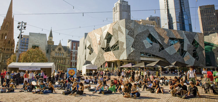Photograph of Melbourne's iconic Federation Square with a large crowd gathered