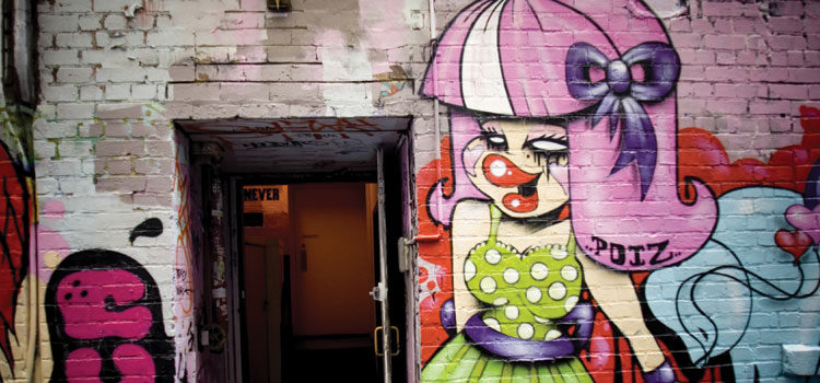 Photograph of a graffiti girl in Melbourne's famous laneways