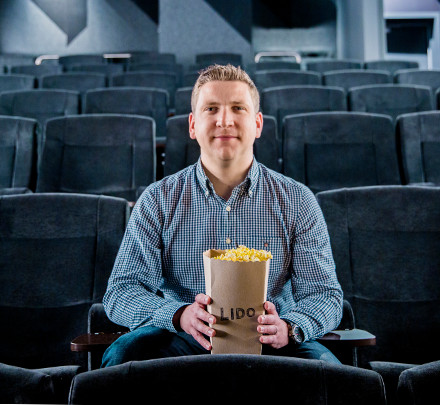 Liam Burke, a media studies lecturer at Swinburne, holds a carton of popcorn in Hawthorn's Lido Cinemas.