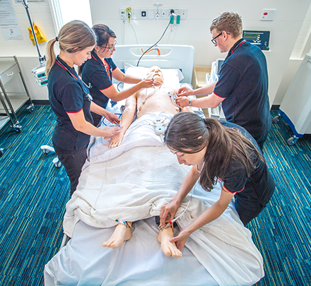 nursing Students treating simulated dummy