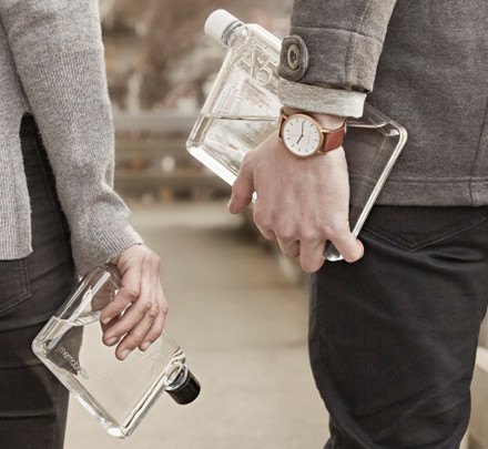 People hold memobottles, a product designed by Swinburne graduate Jesse Leeworthy.