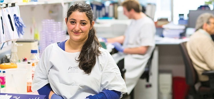 Vonnie, who did an IBL placement at the Peter MacCallum Cancer Centre, photographed in a lab coat working at the Centre.